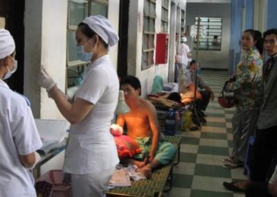 patients in stretchers in the corridor